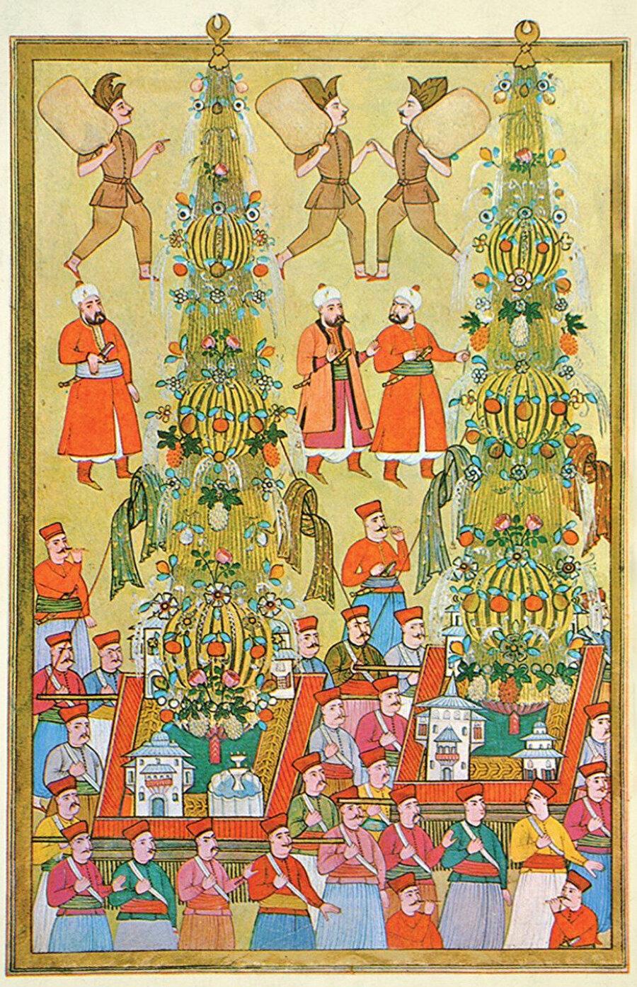 Bir başka sünnet alayında taşınan iki nahıl (Surnâme-i Vehbî, TSMK, III. Ahmed, nr. 3593, vr. 161a).
