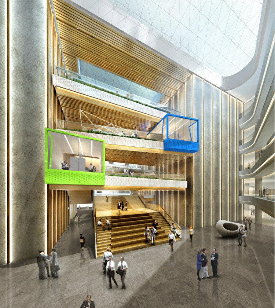 Merdivenlerin her katında çalışanlar için cam toplantı odası bulunuyor.