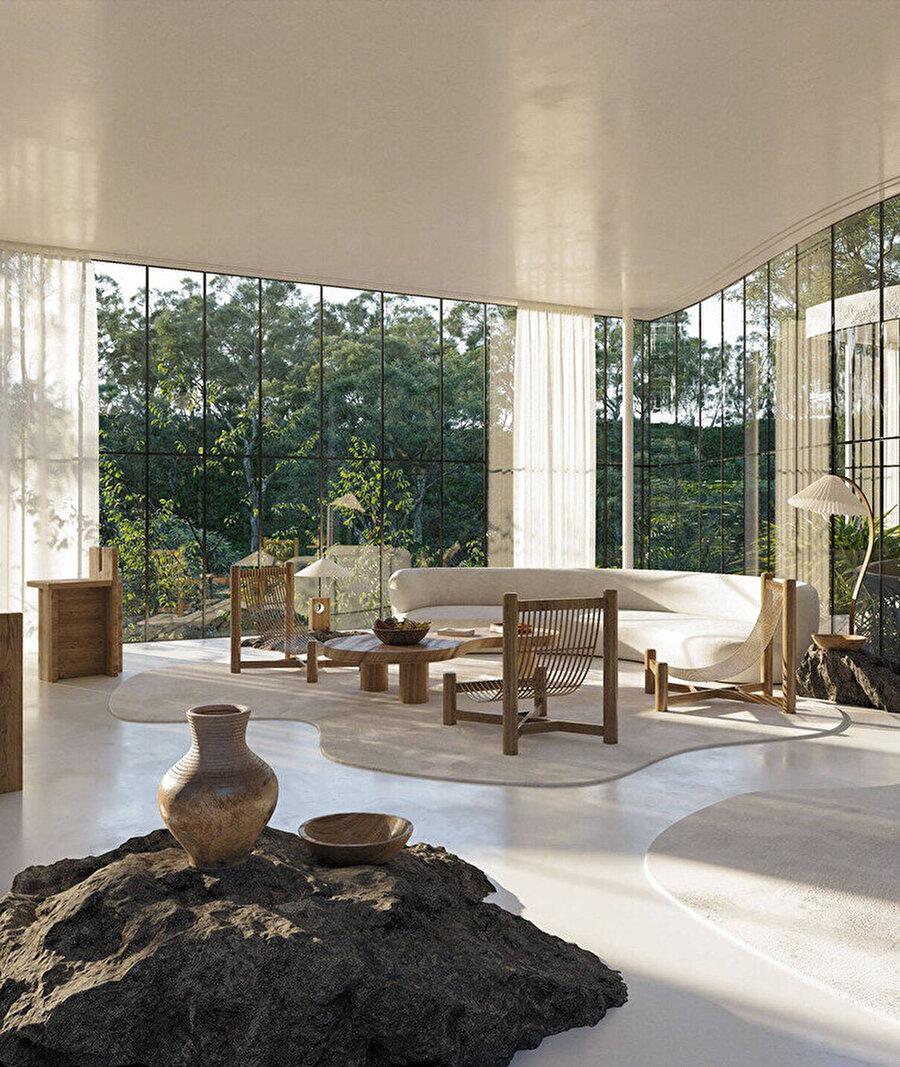 Oturma odasında, kıvrımlı bir kanepe, birkaç özel tasarım koltuk ve akordeon katlamalı, gölgeli bir zemin lambası yer alıyor.