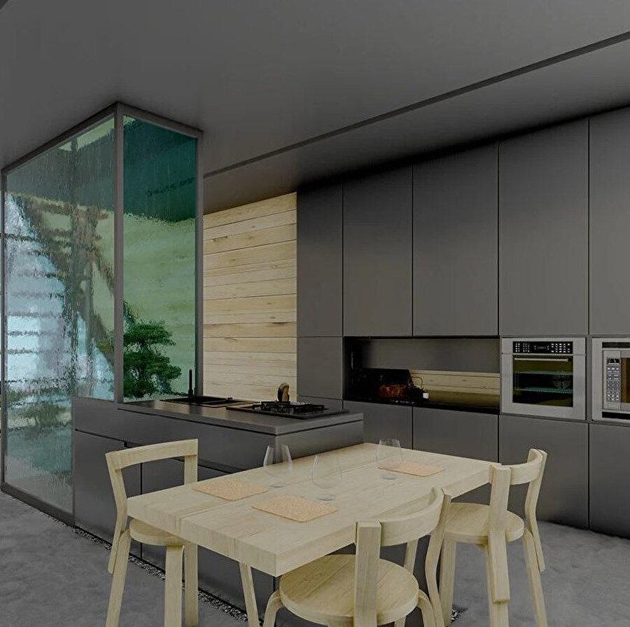 Gri rengin hakim olduğu mutfak dolaplarına, doğal ahşap tonlarındaki mobilyalar eşlik ediyor.