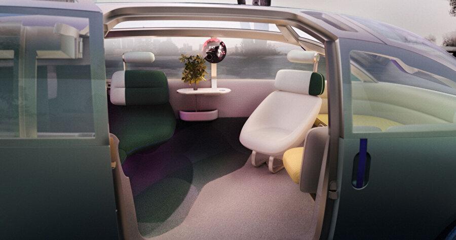 Bir araçtan ziyade bir odada olma hissini oluşturmak için küçük yan sehpaya yerleştirilen MINI Token etkinleştirilebiliyor.
