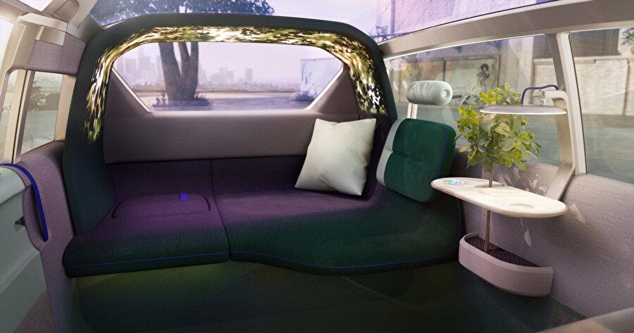 Müzik ve doğa sesleri eklentisine sahip olan aydınlatmalı kemer Loop, arkadaki oturma ünitesinin üzerine uzanıyor ve isteğe bağlı olarak çeşitli görüntüleri yansıtıyor.
