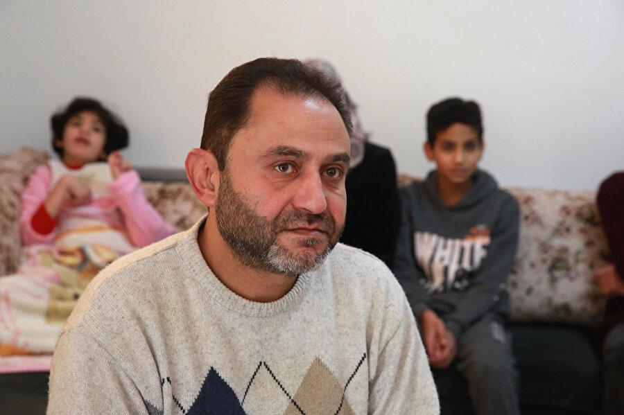 Usame Rasras, İsrail'in eşine Batı Şeria kimlik kartı vermediği için sıkıntılı bir hayat yaşadıklarını söyledi.
