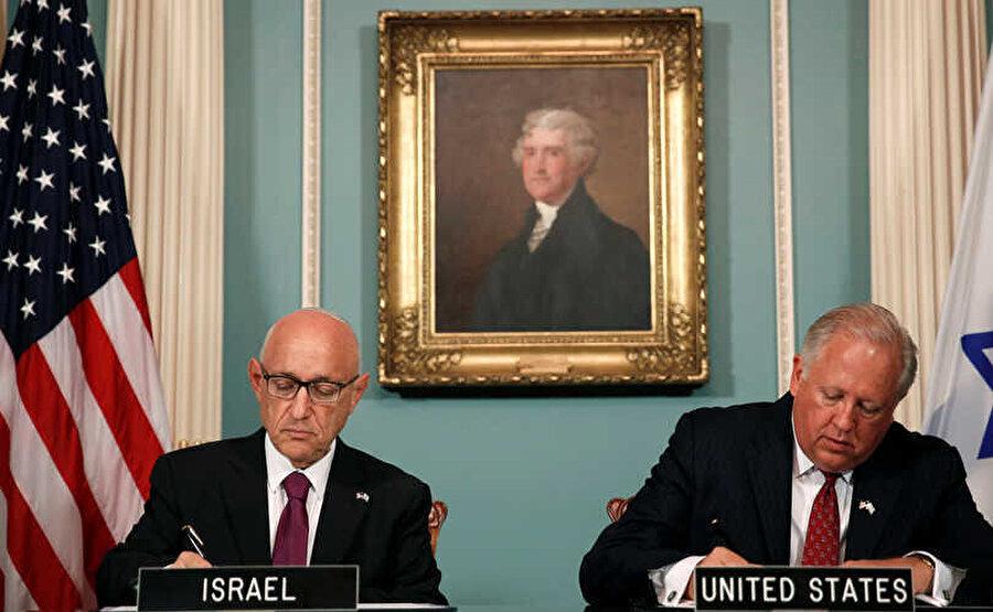 ABD Müsteşarı Tom Shannon ile Ulusal Güvenlik Danışmanı Temsilcisi Jacob Nagel, 2016 yılında iki ülke arasında Güvenlik Yardım Anlaşması'nı imzalarken. 10 yılı kapsayacak olan anlaşma ile ABD, İsrail'e toplamda 38 milyar dolar yardım yapmayı taahhüt etmişti.