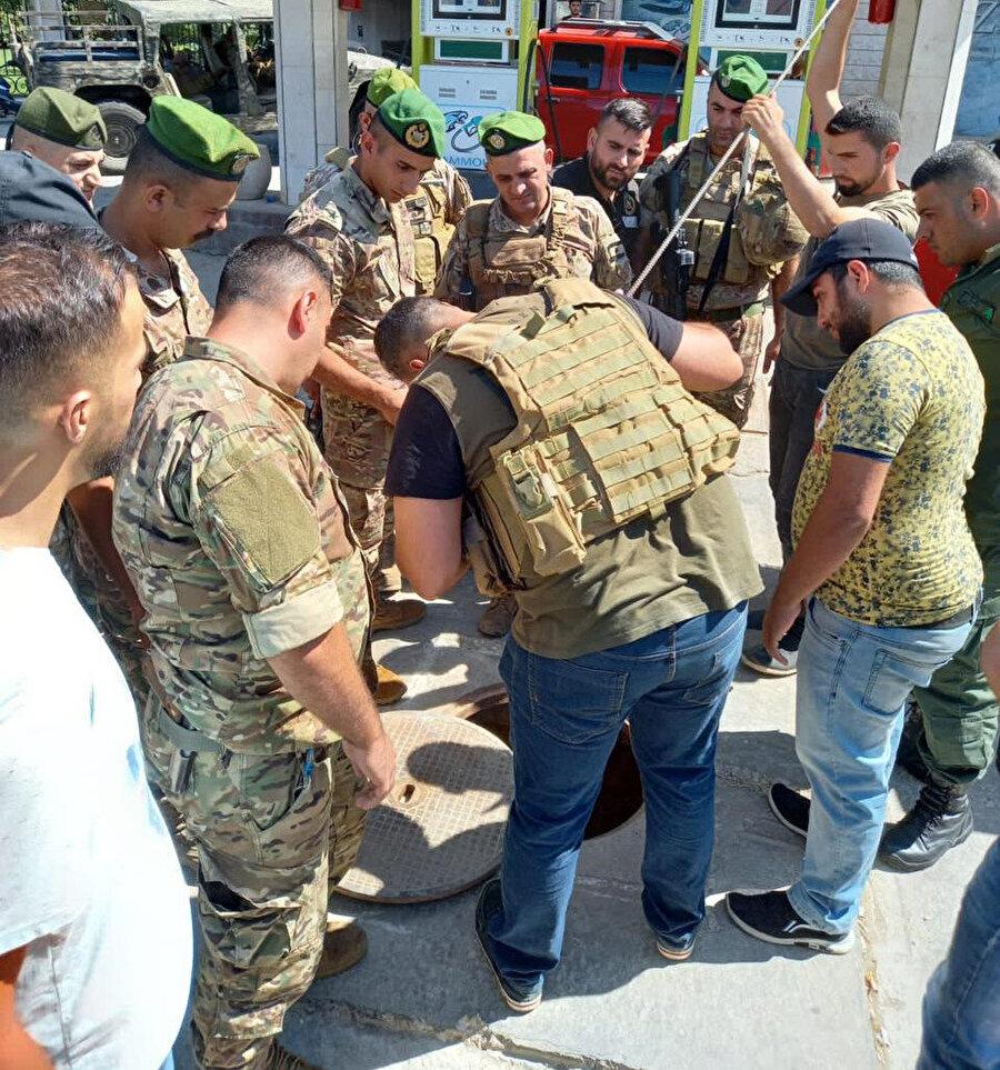 Lübnan ordusunun satış yapmayan akaryakıt istasyonlarına düzenlediği baskınlardan bir görüntü.