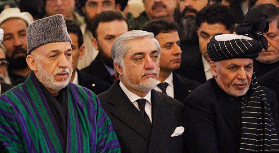 Afganistan İslam Cumhuriyeti'nin eski devlet başkanları Hamid Karzai(solda) ve Eşref Gani(sağda), Taliban tarafından kukla yönetimin idarecileri olarak tanımlanıyor.