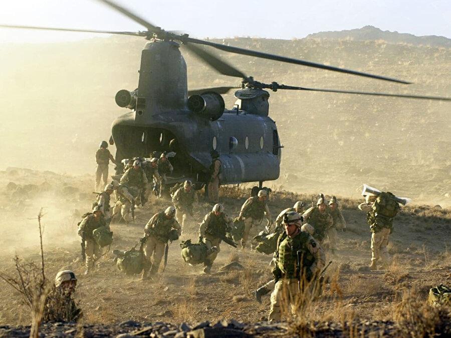 11 Eylül saldırılarını bahane eden Amerika 7 Ekim 2001'de Afganistan'ı işgal etmişti.