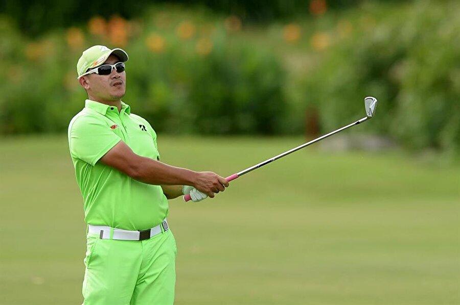 Angelo Que                                                                           Filipinli golfçü.