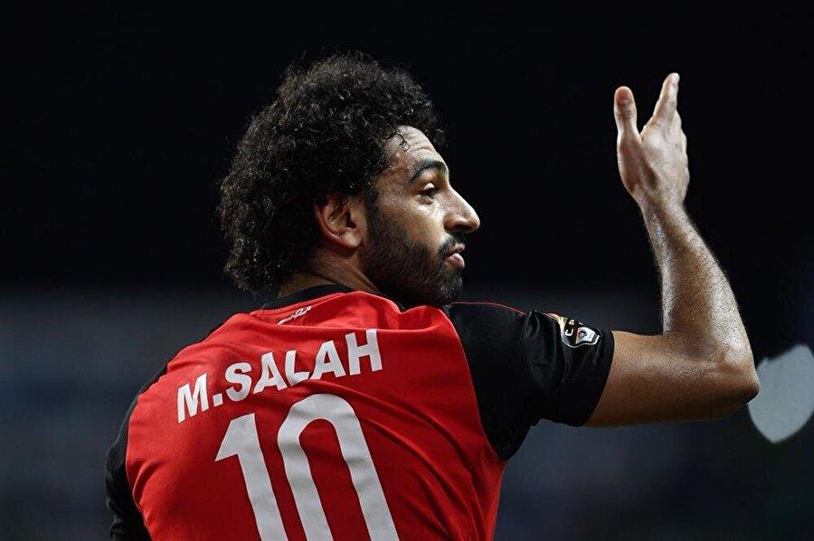 57 maç 33 gol                                                                           Mısır Milli Takımı formasını 57 maçta giyen 33 gol attı.