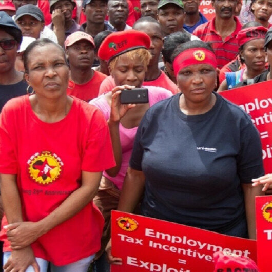 Workers march across South Africa over job losses, corruption