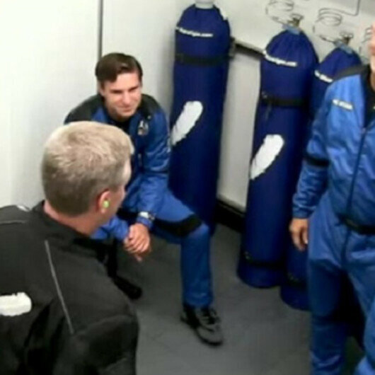 Billionaire Bezos, crew blast off into space on successful visit