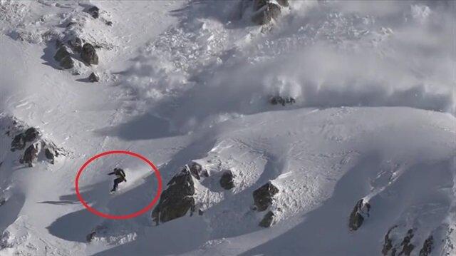 Çığa neden olup kıl payı kurtulan snowboardcu