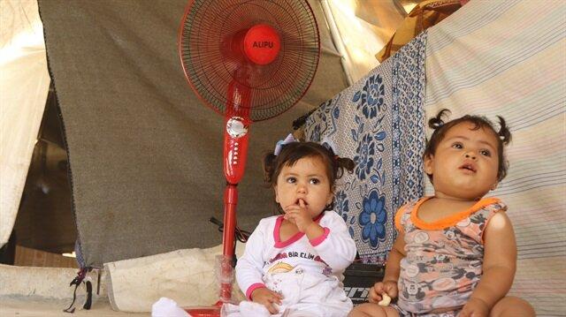 Çadırlarda yaşam mücadelesi veren ailelere vantilatör dağıtıldı