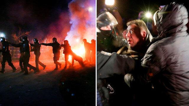 Vuhan'dan getirilenleri taşlayan Ukraynalılar polisle çatıştı.