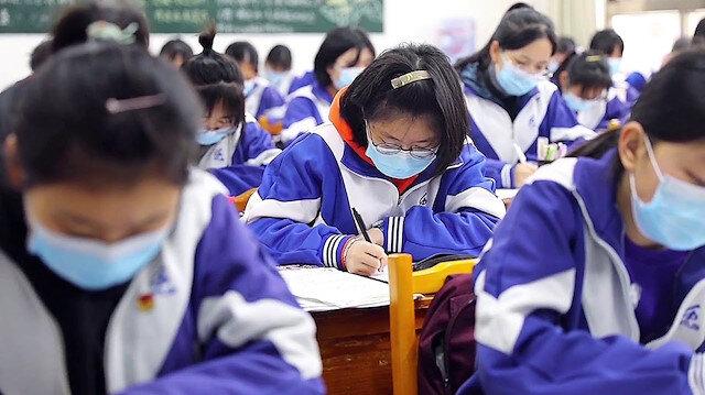 Çin'de öğrenciler okullara döndü: Okul girişlerinde termal kameralar olacak