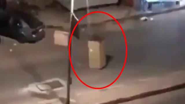 Karantina yasağına takılmamak için karton kılığına girdi