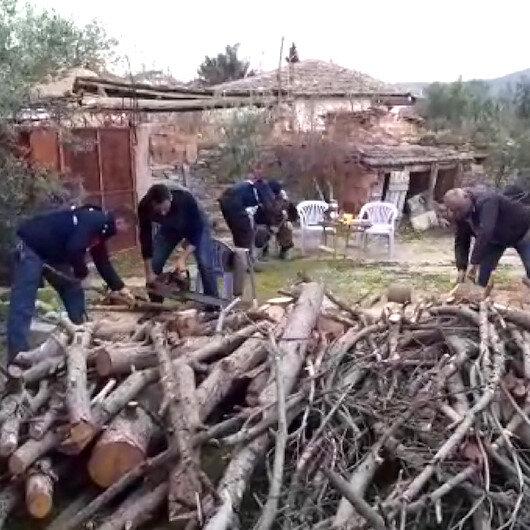 Jandarma şehit annesinin odunlarını kesti