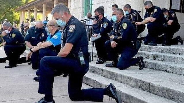 ABD'de polisler protestocular karşısında diz çöktü