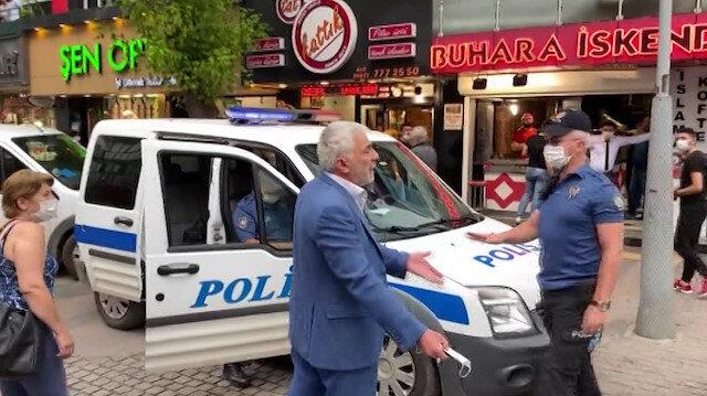 Hem maskeyi takmadı hem de şov yapmayın diyerek polise tepki gösterdi