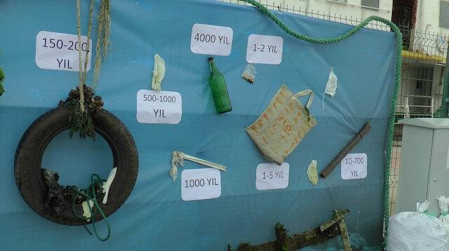 Tuzla'da farkındalık için denizden çuval çuval atık çıkarıldı
