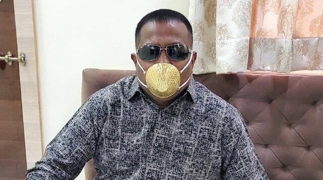 Hindistan'da bir kişi virüsten korunmak için yaklaşık 4 bin dolara altından maske yaptırdı