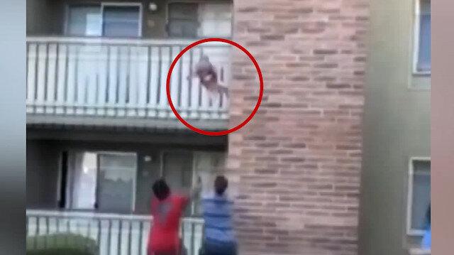 ABD'de eski futbolcunun yanan binanın 3. katından düşen bebeği kurtardığı anlar kamerada