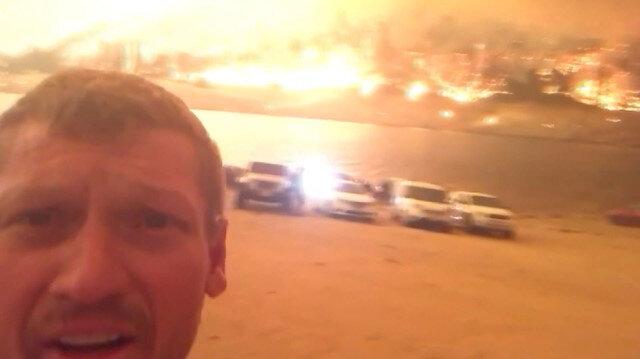 California'daki yangında alevlerin arasında kalan kampçılar o anları kamerayla görüntüledi