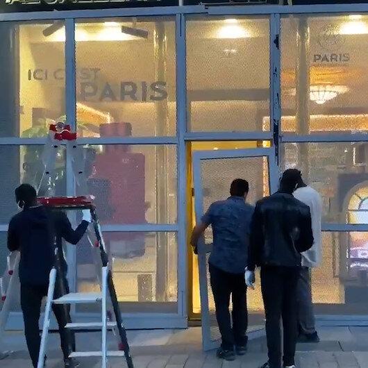 Pariste sarı yeleklilerin yağmalarına karşı büyük mağazalar önlem aldı