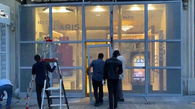 Paris'te sarı yeleklilerin yağmalarına karşı büyük mağazalar önlem aldı