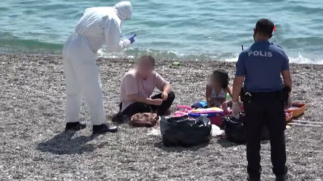 Karantinayı delen kadın sahilde ölmek istemiyorum diye bağırarak ortalığı birbirine kattı