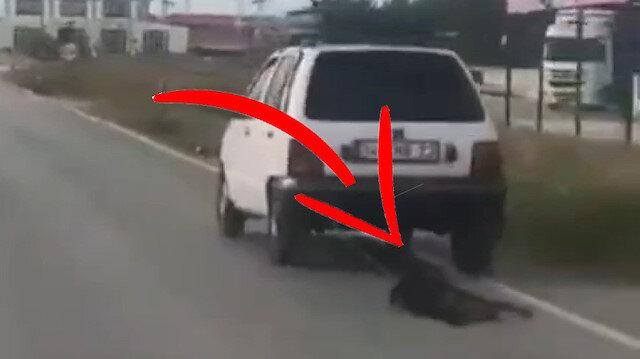 Cani adam, aracına bağladığı köpeği metrelerce sürükledi