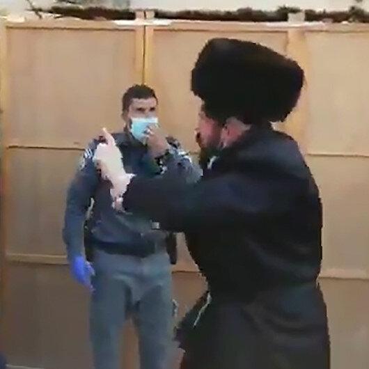 Koronavirüsten ölen hahamın cenazesine katılan Ultra-Ortodoks Yahudiler ortalığı birbirine kattı
