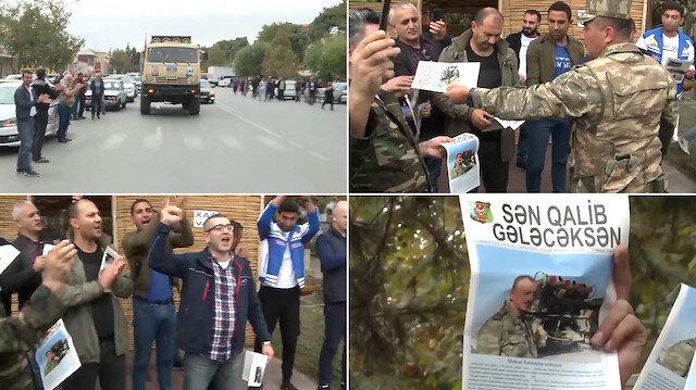 Azerbaycan ordusu yetkilileri coşkulu kalabalığa işgalden kurtarılan bölgelerin bildirisini yapıyor