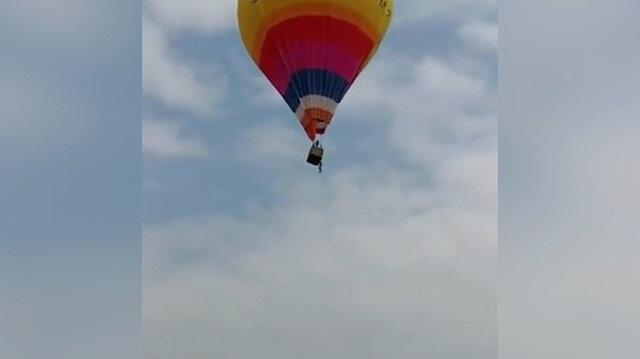 Çin'de uçan balonla test uçuşu yapan görevli, yere çakıldı