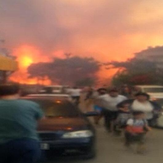 Orman yangını büyüyor: Vatandaşın panik halinde alevlerden kaçışı kamerada