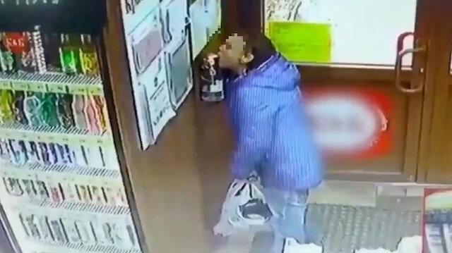 Rusya'da market müşterisi su içer gibi dezenfektan içti