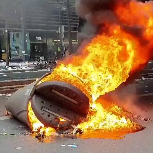 Pariste sokağa çıkma kısıtlaması protesto edildi: Bank ve çöp bidonları ateşe verildi