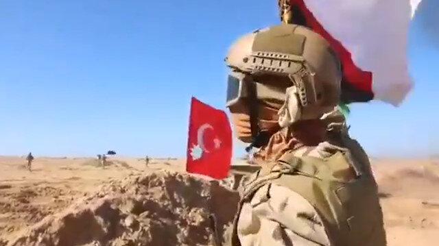Darbeci Hafter güçlerinin tatbikatında Türk bayrağı yere atılıp çiğnendi