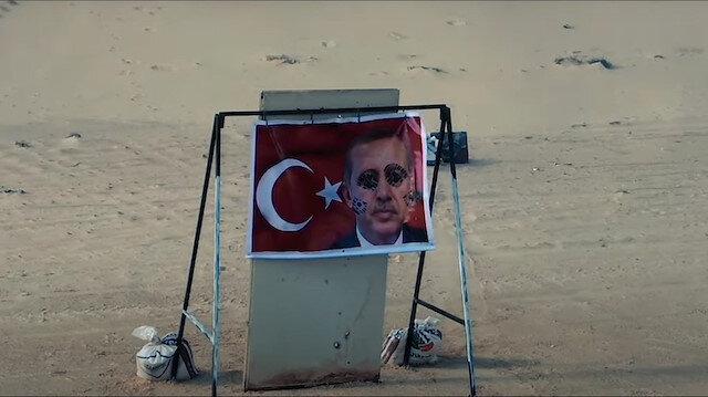 Darbeci Hafter güçlerinin tatbikatında Türk bayrağı ve Cumhurbaşkanı Erdoğan'ın fotoğrafı yere atılıp çiğnendi