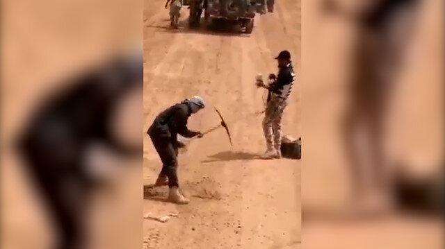 Nijerya'da kazma kürekle mayın temizliği cep telefonu kamerasına yansıdı