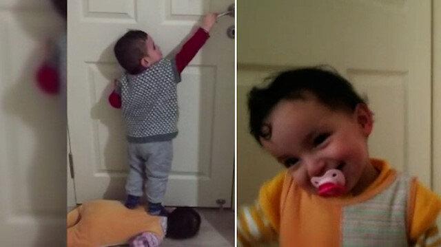 Minik ikizlerin kapı açma numarası görenleri hayrete düşürdü
