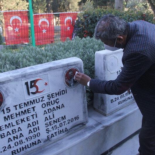 Ömer Çelik'ten mezar taşları kırılan ikiz şehitlerin babasına saldırganlar yakalanacak sözü