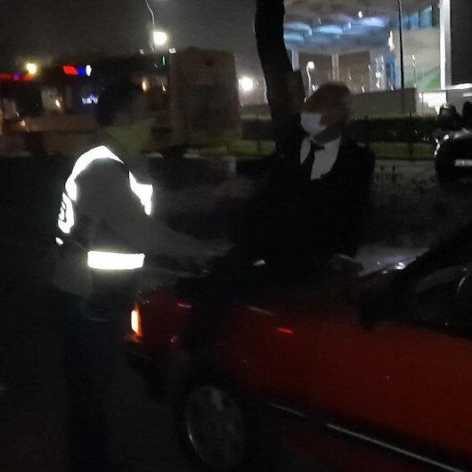 Bursada alkollü sürücü aracını bağlatmamak için kaputa oturup polislere direndi