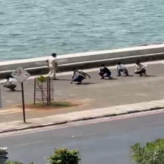 Hindistan'da maske takmayanlara ördek yürüyüşü cezası