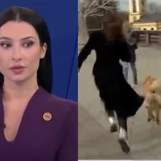 Rus muhabir canlı yayında mikrofonunu köpeğe kaptırdı