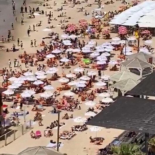 Maske zorunluluğunun kalktığı İsrailde halk plajlara akın etti