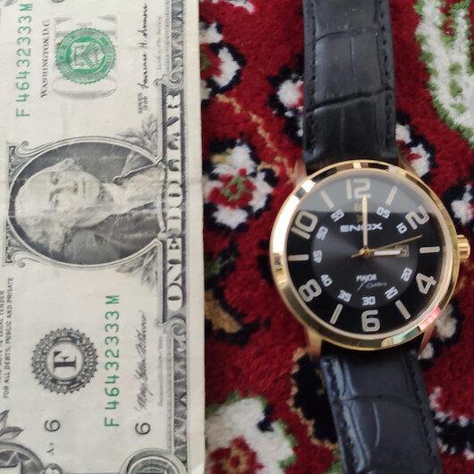 FETÖ elebaşı imzalı saatin ve F serisi 1 dolarların bulunduğu FETÖ operasyonu kamerada