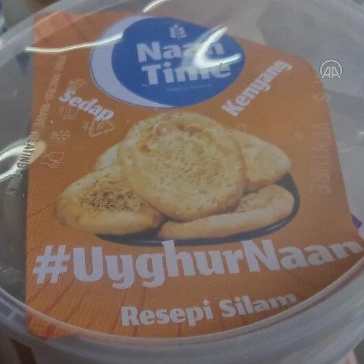 Malezyada Uygur Türklerinin yaşadıkları zulümlere dikkat çekmek için Uygur ekmeği dağıtıldı