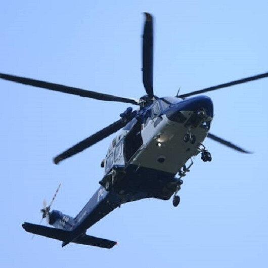 Yeni Zelanda'da bir firari teslim olmak için polis merkezine helikopterle gitti