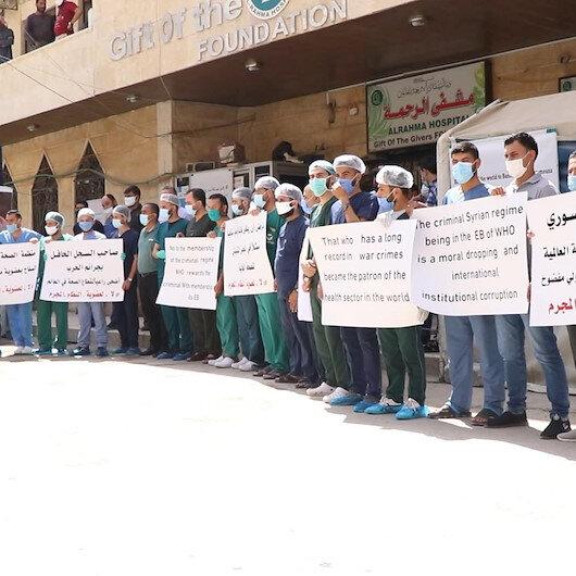 Suriyeli sağlık çalışanları Esad rejiminin DSÖ'nün Yürütme Kuruluna üye seçilmesini protesto etti